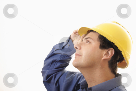 Overseeing Progress stock photo, A man wearing hardhat  looking upwards by Leah-Anne Thompson