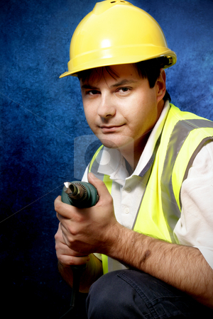 Handyman stock photo, The handyman can!Worker with drill on blue and black background by Leah-Anne Thompson