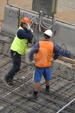 Men at work stock photo, Two construction men at a worksite by Leah-Anne Thompson