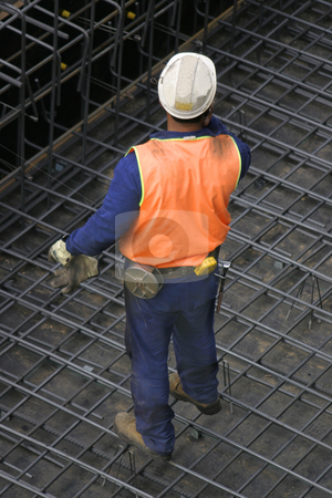 Lone Builder stock photo, One builder standing on wire mesh by Leah-Anne Thompson
