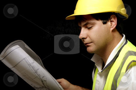 Industrial Planning stock photo, Workman or builder with architectural plans by Leah-Anne Thompson