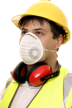Builder or Carpenter with Face Mask stock photo, A worker wearing safety face mask, ear muffs and hard had by Leah-Anne Thompson