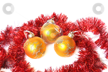 Christmas balls and a tinsel stock photo, Golden Christmas balls and red tinsel. Isolated on white by Olga Lipatova