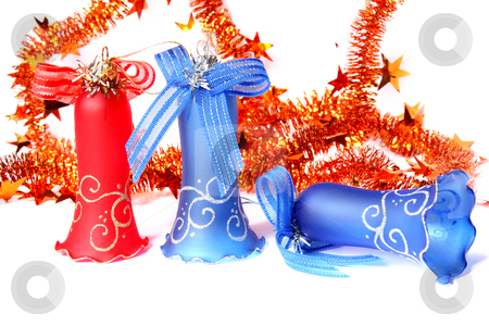 Christmas Bells stock photo, Blue and red Christmas Bells and tinsel. Isolated on white by Olga Lipatova