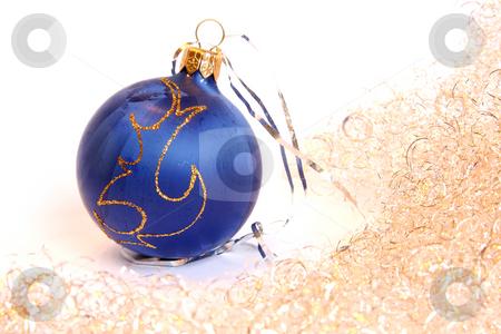 Christmas ball and a tinsel stock photo, Blue Christmas ball and golden tinsel. Isolated on white by Olga Lipatova