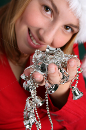 Christmas Decorations stock photo, Teenager in red holding a string of silver Christmas Decorations by Vanessa Van Rensburg
