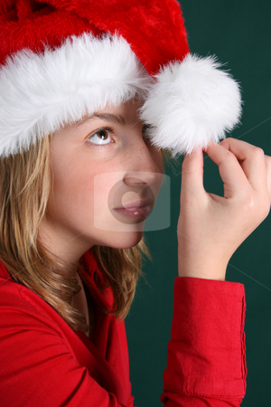 Christmas Hat stock photo, Teenager wearing a red shirt and a christmas hat by Vanessa Van Rensburg