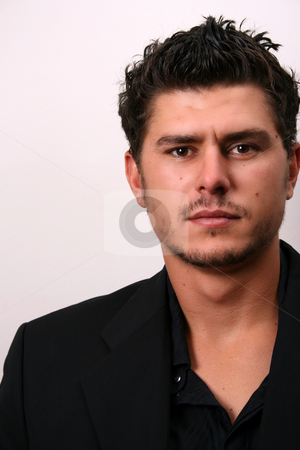 Male Model in Suit Close Up stock photo, Male model in studio against white wall by Vanessa Van Rensburg