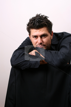 Leaning stock photo, Male model in studio against white wall by Vanessa Van Rensburg