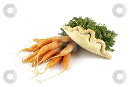 Carrots and Pasty stock photo, Contradiction between healthy food and junk food using bunch of carrots and pasty on a reflective white background by Keith Wilson