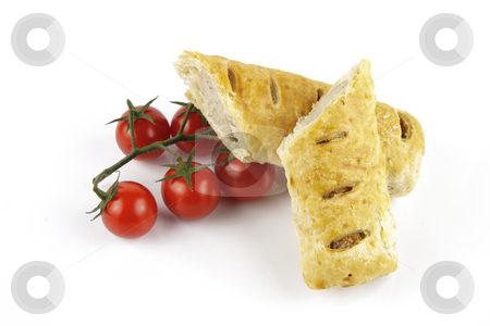 Tomatoes and Sausage Roll  stock photo, Contradiction between healthy food and junk food using tomatoes and a sausage roll on a reflective white background by Keith Wilson