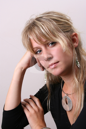 Blond Model in Black stock photo, Blond Female model on a white background wearing a blue top by Vanessa Van Rensburg