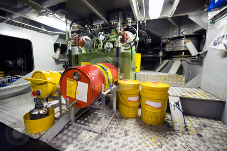 Engine room stock photo, The engine room with the oil pump for lubrication of a tugboat by Corepics VOF