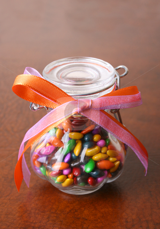 Glass Barrel stock photo, Small glass barrel filled with candy and decorated with ribbon by Vanessa Van Rensburg