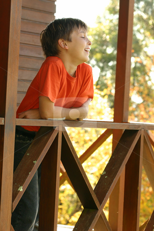 Country Life stock photo, Happy child leaning on the porch balustrade by Leah-Anne Thompson