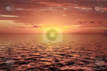 Beautiful tropical sunrise stock photo, Beautiful tropical sunrise on the island of mauriitus during summertime with reflecting light on the ocean. by Gowtum Bachoo