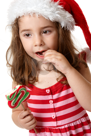 Little girl eating candy stock photo, Young little girl eating a christmas tree candy by Leah-Anne Thompson