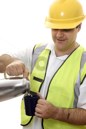 Rest Break stock photo, Worker pours water from a flask into a mug by Leah-Anne Thompson
