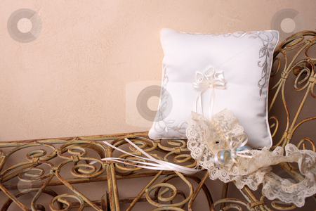 Ring Pillow and Garter stock photo, Ring Pillow and garter on an old style rustic seat by Vanessa Van Rensburg