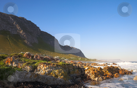 Betties Bay stock photo, Rocky beach on a sunny day on the edge of the water at betties bay in the Western Cape, South Africa. by Sean Nel