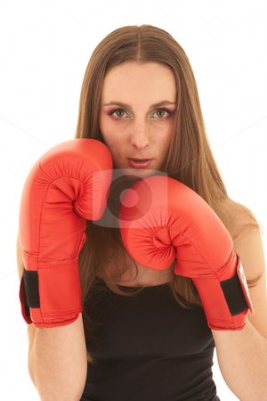 Young boxing woman stock photo, Young adult caucasian woman in a dark casual outfit on a white background in a defensive position with red boxing gloves. NOT ISOLATED by Sean Nel