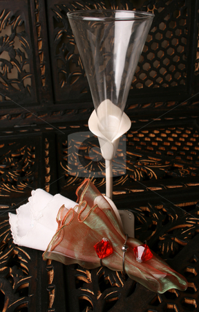 Glass and Napkinl stock photo, Decorated long stem glasses with a White and organza napkin by Vanessa Van Rensburg