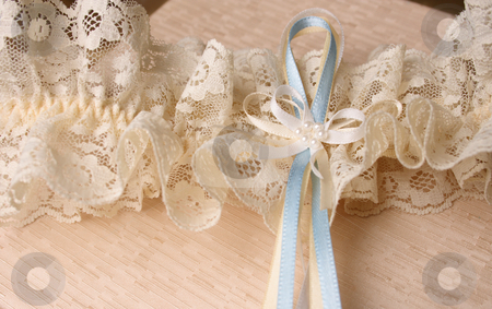 Blue and Cream Ribbons stock photo, Cream Colored Jewellery box and bridal garter by Vanessa Van Rensburg