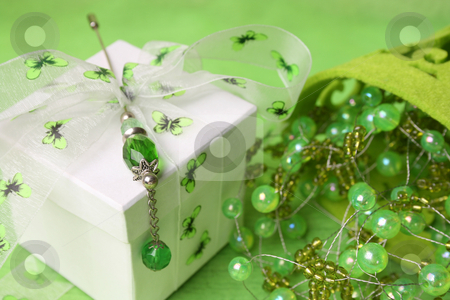 Gift Box with Pin stock photo, White gift box with ribbon and beaded decorations by Vanessa Van Rensburg