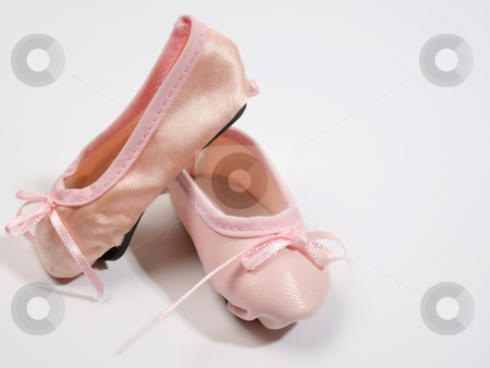 Miniature Shoes stock photo, One Leather and one satin ballet shoe by Vanessa Van Rensburg