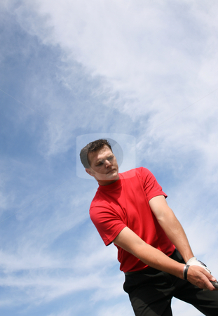 Preparation stock photo, Young golfer at an angle preparing for a shot by Vanessa Van Rensburg