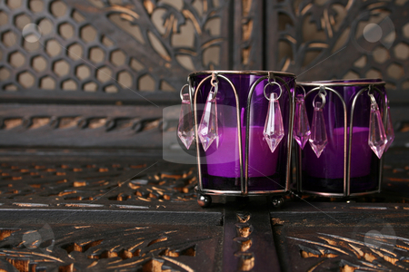 Purple Crystals stock photo, Two purple crystal candle holders on a rustic background by Vanessa Van Rensburg