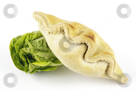 Salad Lettace and Pasty stock photo, Contradiction between healthy food and junk food using a green salad lettace and pasty on a reflective white background by Keith Wilson