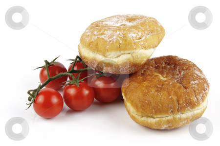 Tomatoes and Doughnuts stock photo, Contradiction between healthy food and junk food using red ripe tomatoes and a doughnuts on a reflective white background by Keith Wilson