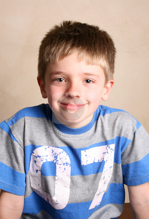 Friendly Boy stock photo, Friendly boy with a blue shirt against a light background by Vanessa Van Rensburg