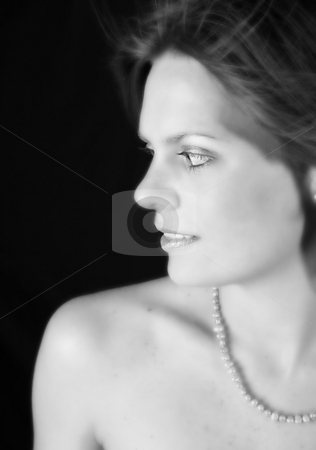 Beautiful Woman stock photo, Beautiful young woman with bare shoulders wearing pearls by Vanessa Van Rensburg