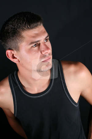 Male Model stock photo, Male model in studio against black background by Vanessa Van Rensburg
