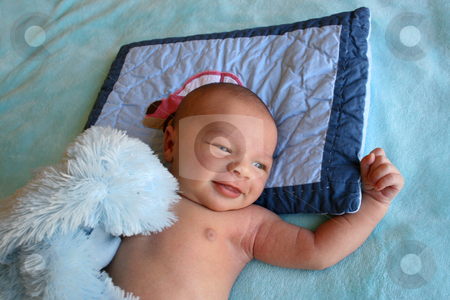 Smiling Baby stock photo, Week old baby boy on a blue blanket early in the morning by Vanessa Van Rensburg
