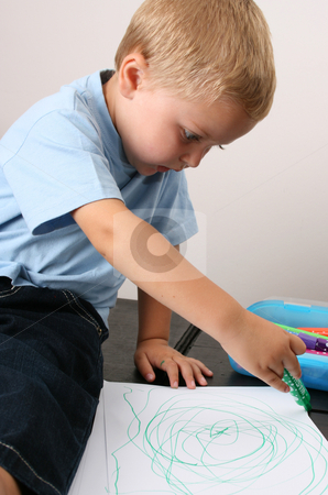 Toddler Drawing stock photo, Toddler drawing on a white sheet with a green pen by Vanessa Van Rensburg