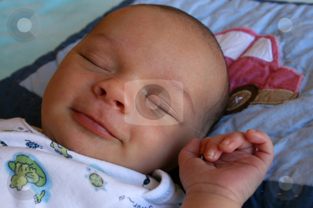 Sleeping Smile stock photo, Week old baby boy on a blue blanket early in the morning by Vanessa Van Rensburg