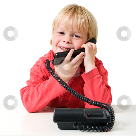 Boy on the phone stock photo, Young blond boy speaking happily into the receiver of a phone by Corepics VOF