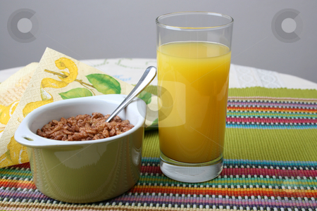 Breakfast with juice stock photo, Cereal in a green bowl with orange juice by Vanessa Van Rensburg
