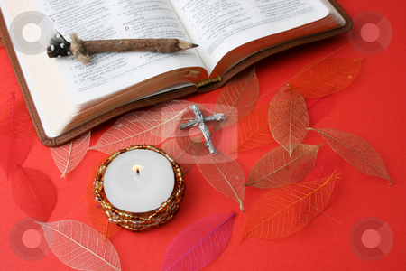 Bible stock photo, Leather bound bible opened at a piece of scripture by Vanessa Van Rensburg