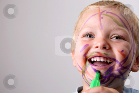 Playing stock photo, Laughing Toddler playing with colored pens making a mess by Vanessa Van Rensburg