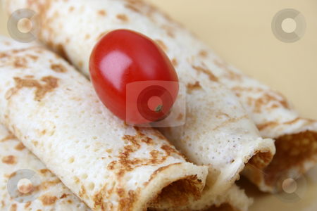Pancakes and a Tomato stock photo, Close up of pancakes on a yellow plate by Vanessa Van Rensburg