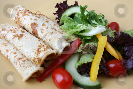 Salad and pancakes stock photo, Barbeque Chicken pancakes and fresh salad on a yellow plate by Vanessa Van Rensburg