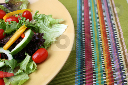 Salad on Plate stock photo, Fresh colorful salad with cherrie tamatoes and cucumber by Vanessa Van Rensburg