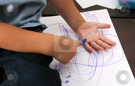 Drawing Hand stock photo, Toddler trying to draw a print of his hand by Vanessa Van Rensburg