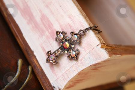 Copper Cross stock photo, Copper Cross haning from a wooden jewellery box by Vanessa Van Rensburg