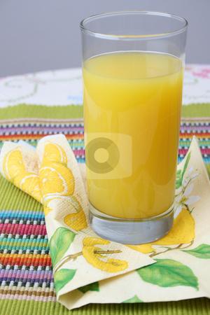 Orange Juice stock photo, Glass of Orange Juice on a serviette by Vanessa Van Rensburg
