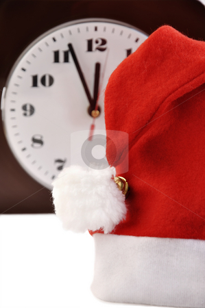 Birth of New Year.  stock photo, Santa red holiday hat and a watch  on white. by Liana Bukhtyyarova